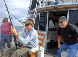 Wild Card angler fighting a tuna on a deep sea offshore charter on the Outer Banks.