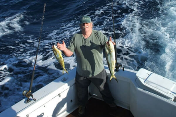 Paul proudly displays mahi he caught out of Oregon Inlet on his Nags Head vacation charter.