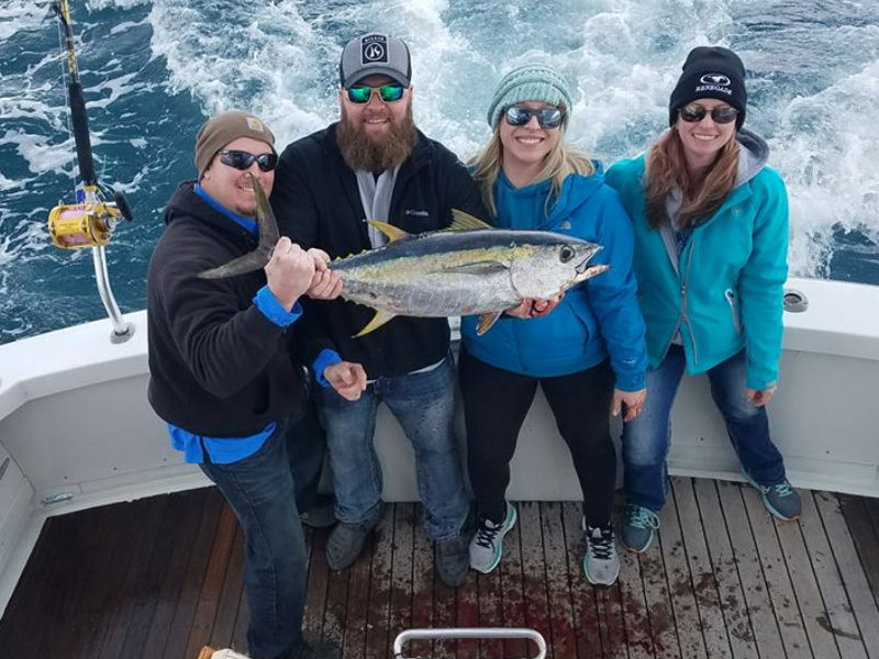 Charter customers displaying their catch of Outer Banks tuna.